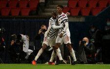 PSG戦で決勝点を挙げたラッシュフォード(右)と、この試合で守備に奮闘したワン・ビサカ photo/Getty Images